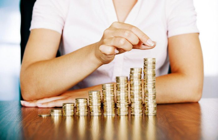 woman stacking gold coins salary currency wealth finance thinkstock 465223667 100580824 large 700x450 - Funding your startup with the ICO and token crowdsales explosion