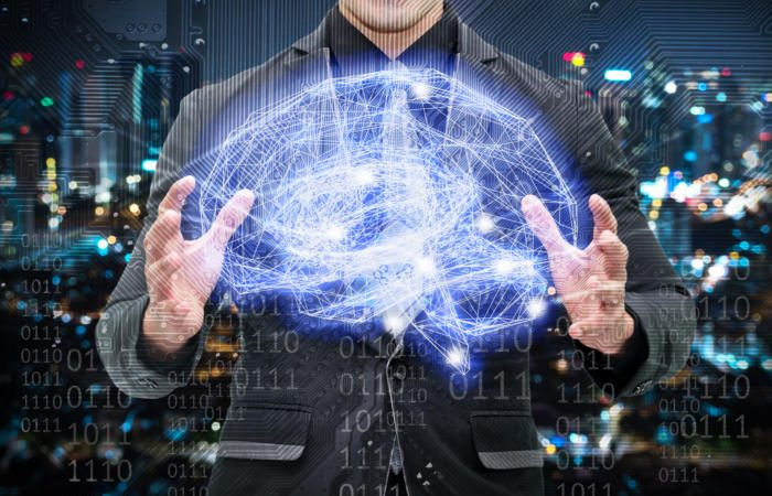 artificial intelligence machine learning binary code virtual circuit brain thinkstock 676338068 100724427 large 700x450 - AI as a way to overcome cognitive bias in physicians