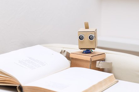 robot reading photo via shutterstock - Machine learning library TensorFlow can count to potato… I mean, 1.7