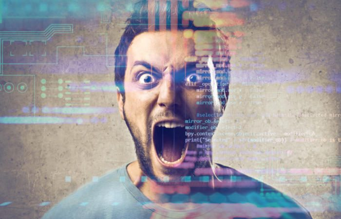 frustrated man with abstract code background 100748430 large 700x450 - LA Fitness, 'Hotel California' and the fallacy of digital transformation