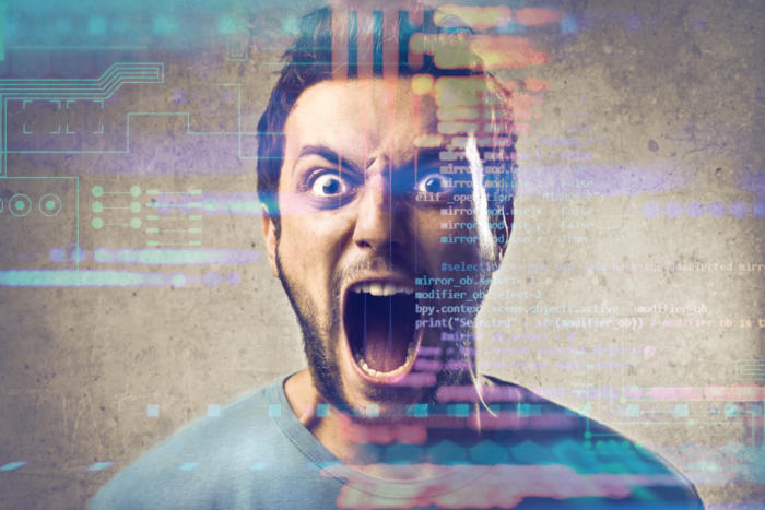 frustrated man with abstract code background 100748430 large - LA Fitness, 'Hotel California' and the fallacy of digital transformation